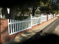 Vinyl picket fence with brick wall & columns